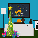 Couple and cat watching television. Happy New Year theme Royalty Free Stock Photo