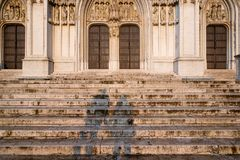A Couple on the Cathedral Steps in Brussels. A shadow of a couple holding hands on steps to the main entrance of the Cathedral of St. Michael and St. Gudula in stock photography