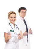 A couple of Caucasian doctors holding thumbs up Stock Photo