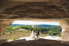 Couple at Cave Entrance. Couple sitting at table at the cave entrance Stock Photos