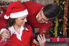 Couple celebrate Christmas night. Beautiful young couple celebrate Christmas night stock image