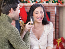 Couple celebrate Christmas night. Couple holding glasses with champagne and celebrate Christmas night royalty free stock image