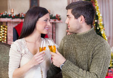 Couple celebrate Christmas night. Couple holding glasses with champagne and celebrate Christmas night stock image