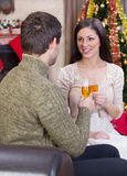 Couple celebrate Christmas night. Couple holding glasses with champagne and celebrate Christmas night royalty free stock photos