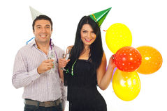 Couple celebrate new year together. Happy couple celebrate new year night together and holding glasses with champagne isolated on white background Royalty Free Stock Photos