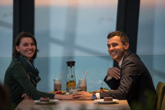 Couple on a romantic dinner at the restaurant. Couple celebrate Valentine`s day with romantic dinner in restaurant near the window stock images