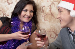 A couple celebrates Christmas. Young and beautiful couple exchanged Christmas gifts Stock Photos