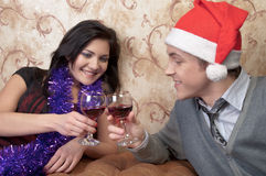 A couple celebrates Christmas. Young and beautiful couple exchanged Christmas gifts Stock Image