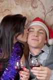 A couple celebrates Christmas. Young and beautiful couple exchanged Christmas gifts Stock Photo