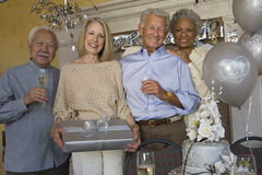 Couple Celebrating 25Th Anniversary. Portrait of senior couple celebrating 25th anniversary with friends Stock Image