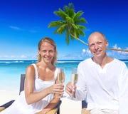 Couple Celebrating on the Beach Stock Photos