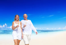 A couple celebrating on the beach Stock Photography