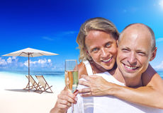 A couple celebrating on the beach Stock Image