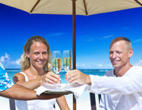 A couple celebrating on the beach Stock Images