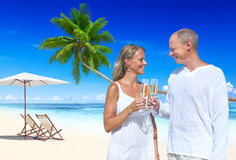 Couple Celebrating Beach Romance Travel Honeymoon Concept Stock Photos