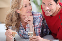 Couple celebrating with champagne Stock Image