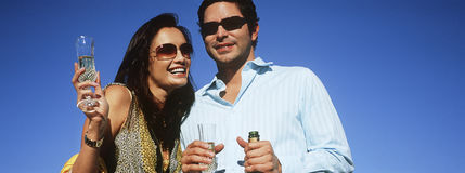 Couple Celebrating With Champagne Royalty Free Stock Photos