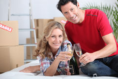 Couple celebrating with champagne. Royalty Free Stock Images