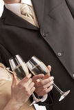 Couple celebrating with champagne, toasting Royalty Free Stock Photos