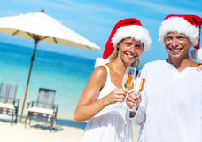 Couple Celebrating Christmas Beach Vacation Concept Stock Images
