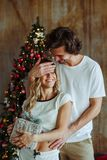 Couple celebrating Christmas at home stock photography
