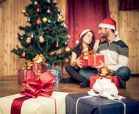 Couple celebrating Christmas and New Year's day Stock Images