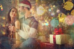 Couple celebrating Christmas and New Year's day Royalty Free Stock Images