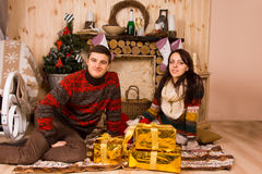 Couple celebrating Christmas in a rustic cabin Royalty Free Stock Photo