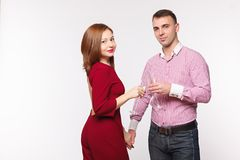Couple celebrating holiday in fashion clothes. Concept marriage, date, st. Valentin`s Day. Isolated on white royalty free stock photography