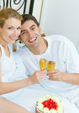 Couple celebrating at home Stock Photography