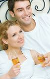 Couple celebrating at home Royalty Free Stock Image