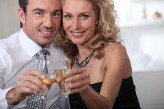 Couple celebrating at home Stock Photo