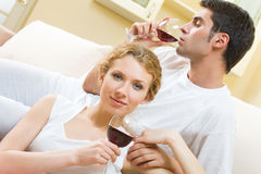 Couple celebrating at home Stock Images