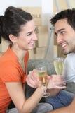 Couple celebrating moving Stock Images