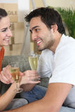 Couple celebrating on moving day Stock Photo