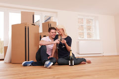 Couple Celebrating Moving Into New Home With Champagne Stock Images