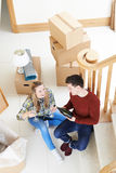 Couple Celebrating Moving Into New Home With Champagne Royalty Free Stock Photography