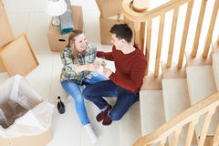 Couple Celebrating Moving Into New Home With Champagne Royalty Free Stock Images