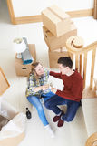 Couple Celebrating Moving Into New Home With Champagne Stock Photos