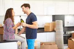 Couple Celebrating Moving Into New Home With Champagne Stock Image
