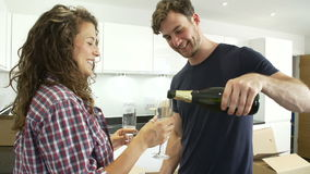 Couple Celebrating Moving Into New Home With Champagne stock video