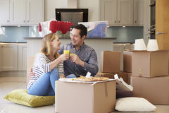 Couple Celebrating Moving Into New Home With Pizza Royalty Free Stock Images