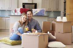 Couple Celebrating Moving Into New Home With Pizza royalty free stock photography