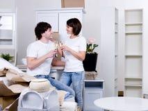 Couple celebrating new apartment stock photos