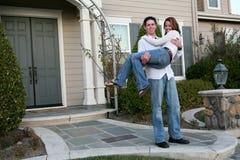 Couple Celebrating New Home Stock Image