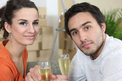 Couple celebrating new home Royalty Free Stock Image