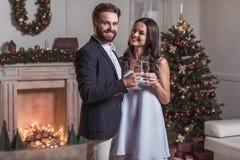 Couple celebrating New Year Stock Images