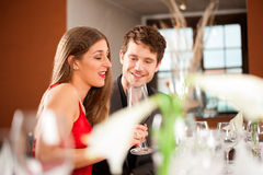 Couple Celebrating an Occasion in Restaurant Stock Photo