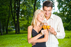 Couple celebrating, outdoors Stock Photos