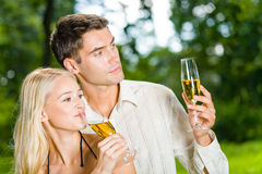 Couple celebrating outdoors Royalty Free Stock Image